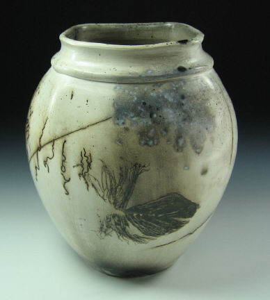 Unglazed horsehair and feather decorative urn with a wax coating