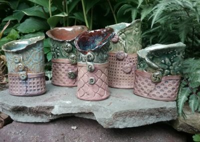 embellished pottery containers